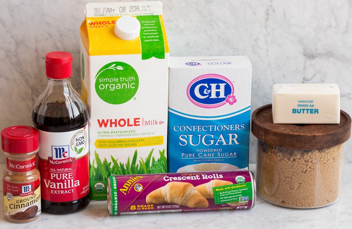 Photo of ingredients used to make mini cinnamon rolls. Includes crescent dough, brown sugar, butter, powdered sugar, milk, vanilla and cinnamon.