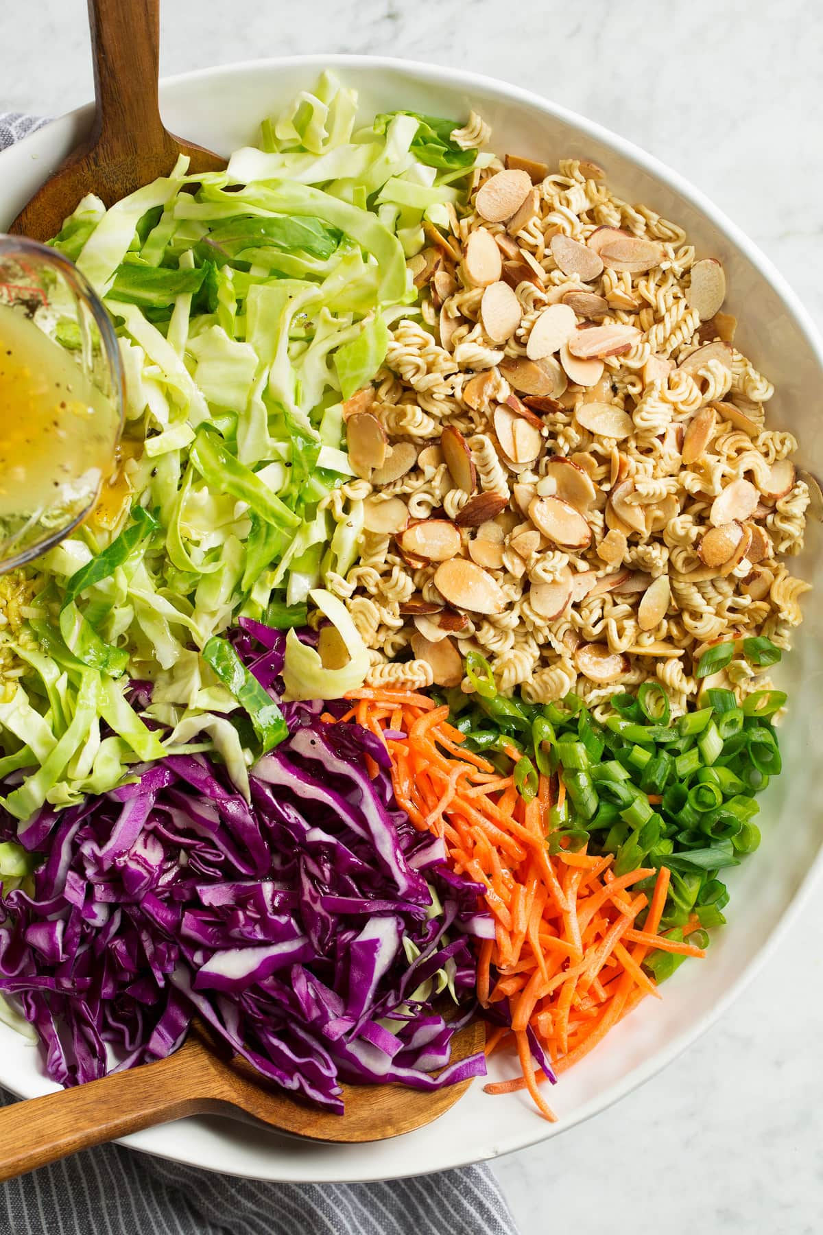 Overhead image of ramen noodle cabbage salad before tossing.