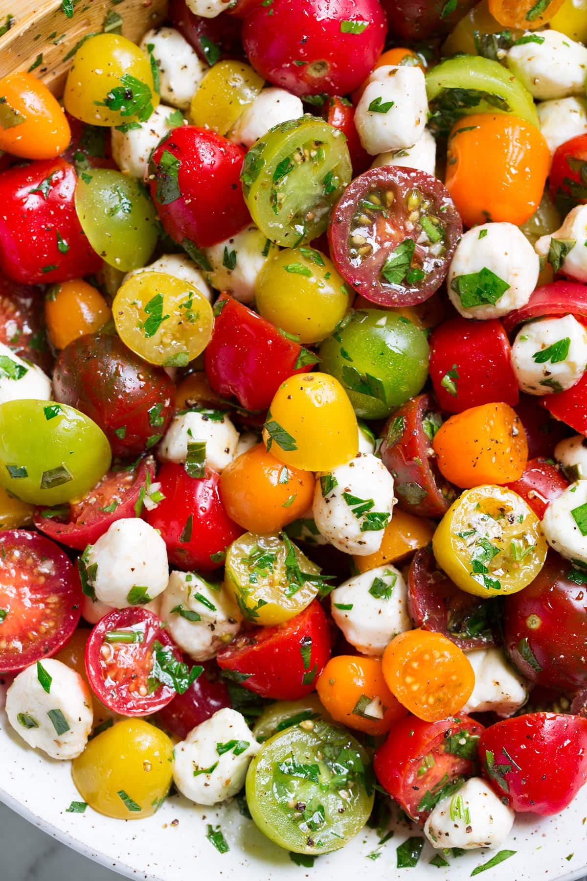 Close up image of tomato salad in a ceramic bowl.