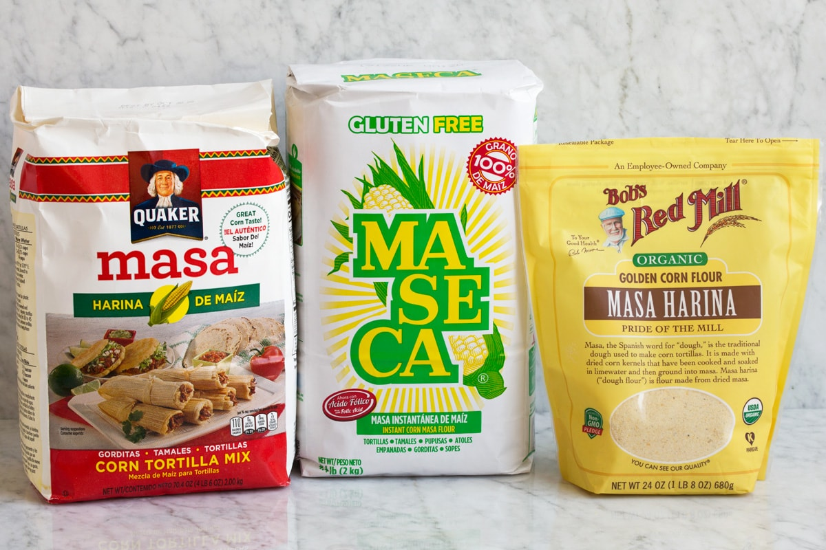 Image of three packages of different brands of masa harina.