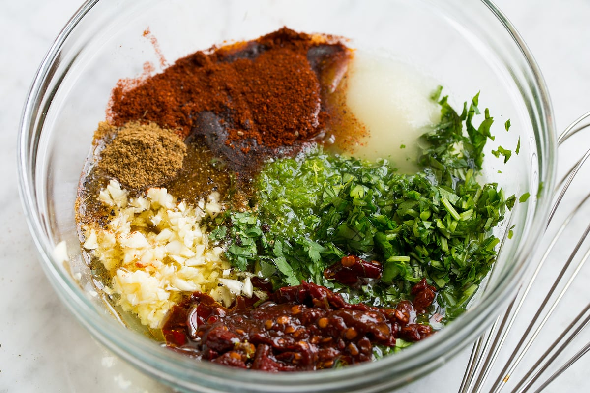Carne asada marinade in a glass mixing bowl shown before mixing.
