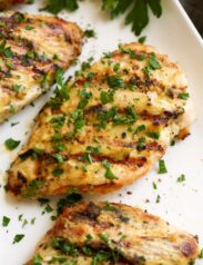 Close up image of grilled creamy garlic dijon chicken.