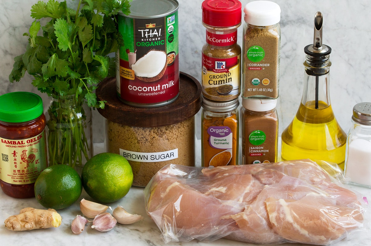 Image of marinade ingredients and chicken for Thai coconut grilled chicken thighs.
