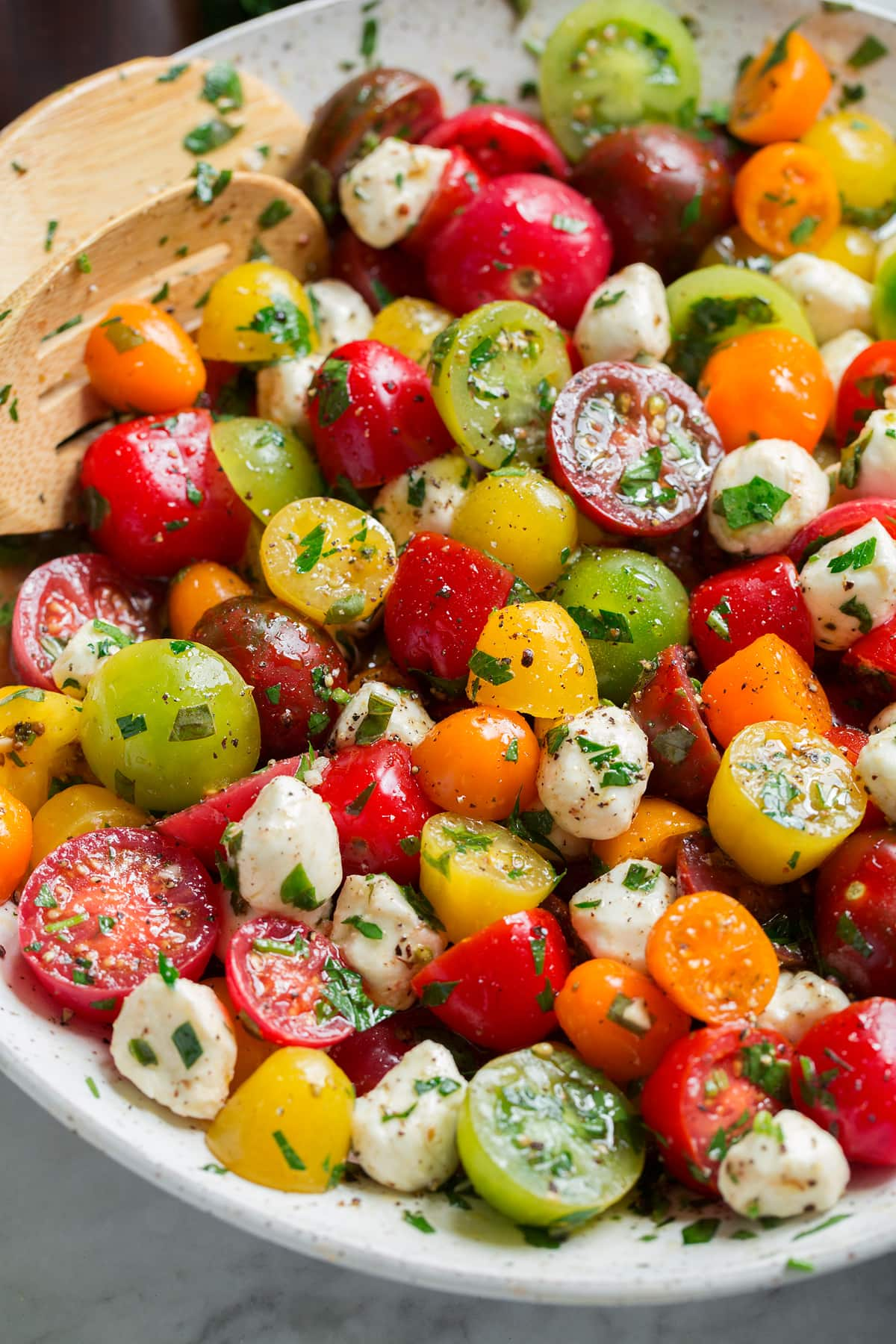 Image showing tomato salad from a side angle in a serving bowl.