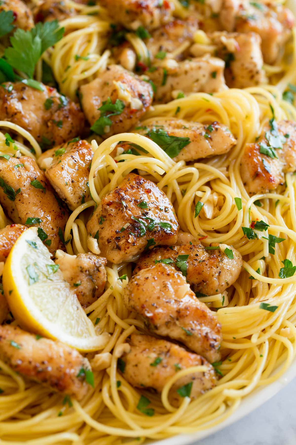 Close up image of chicken scampi and pasta.