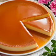 Image of flan with a slice cut.