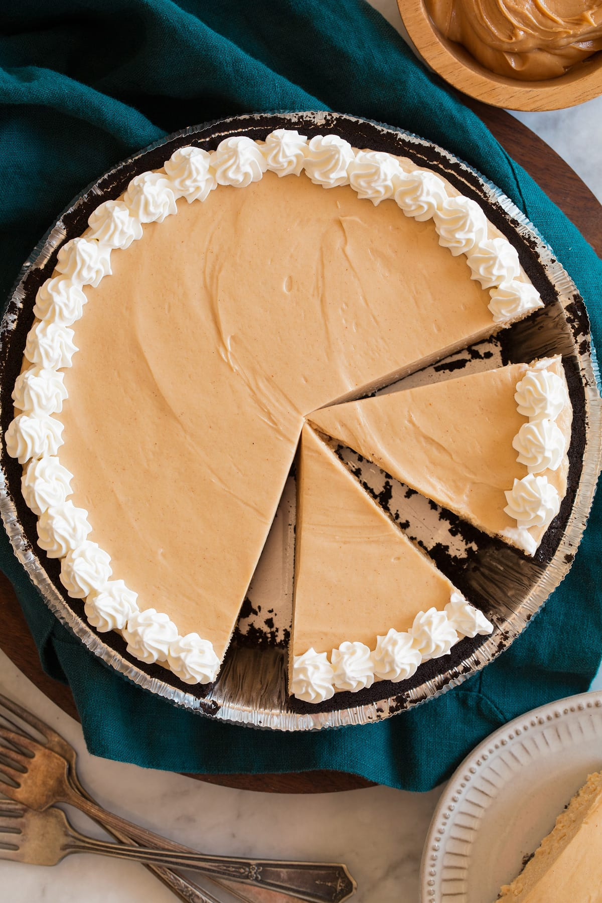 Overhead image of peanut butter pie with a few slices cut.