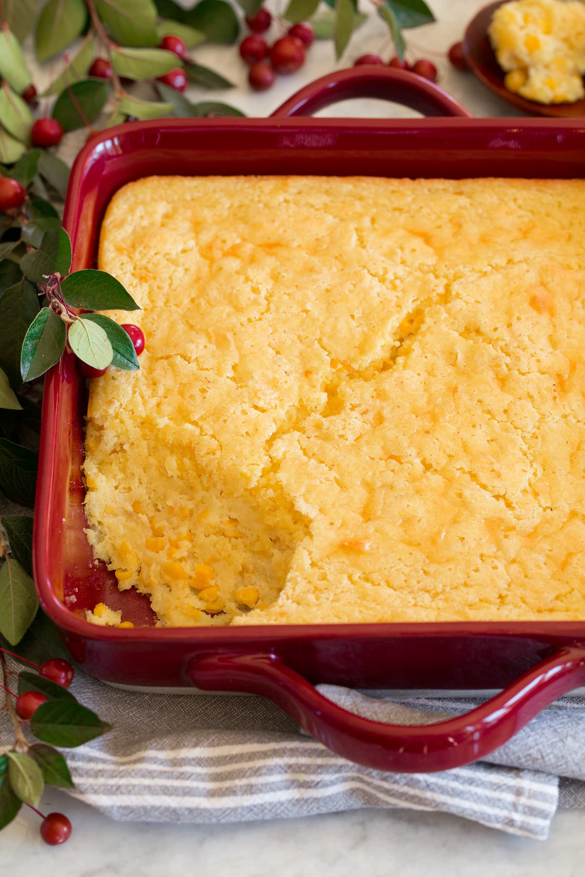 Corn casserole shown from the side with spoon removed.
