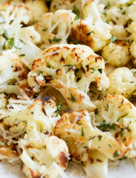 Roasted Cauliflower - this is one of best ways to upgrade mildly flavored fresh cauliflower. This simple method (along with some tasty seasonings) is sure to be one of your favorite ways to cook it!