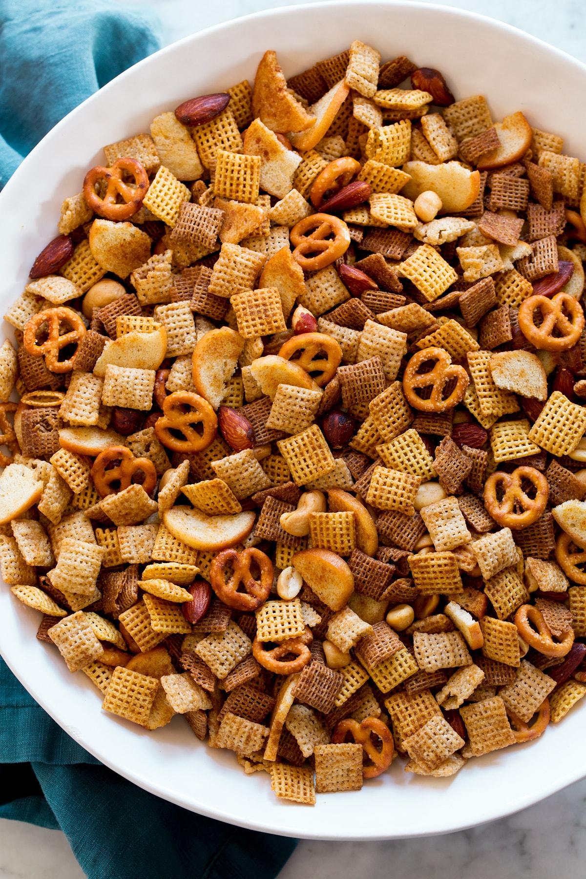 Chex Mix shown from overhead in a big white bowl.