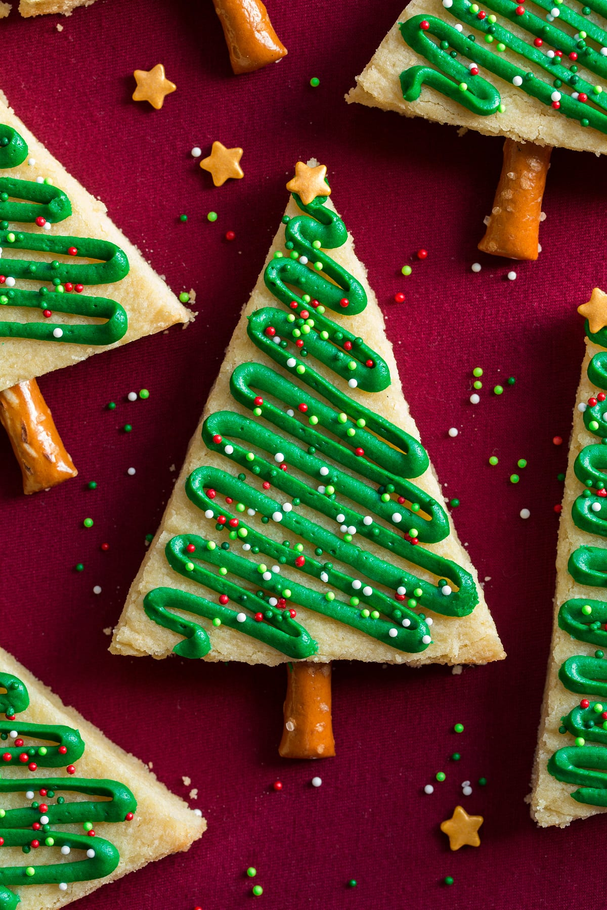 Close up overhead image of a frosted Christmas tree sugar cookie.