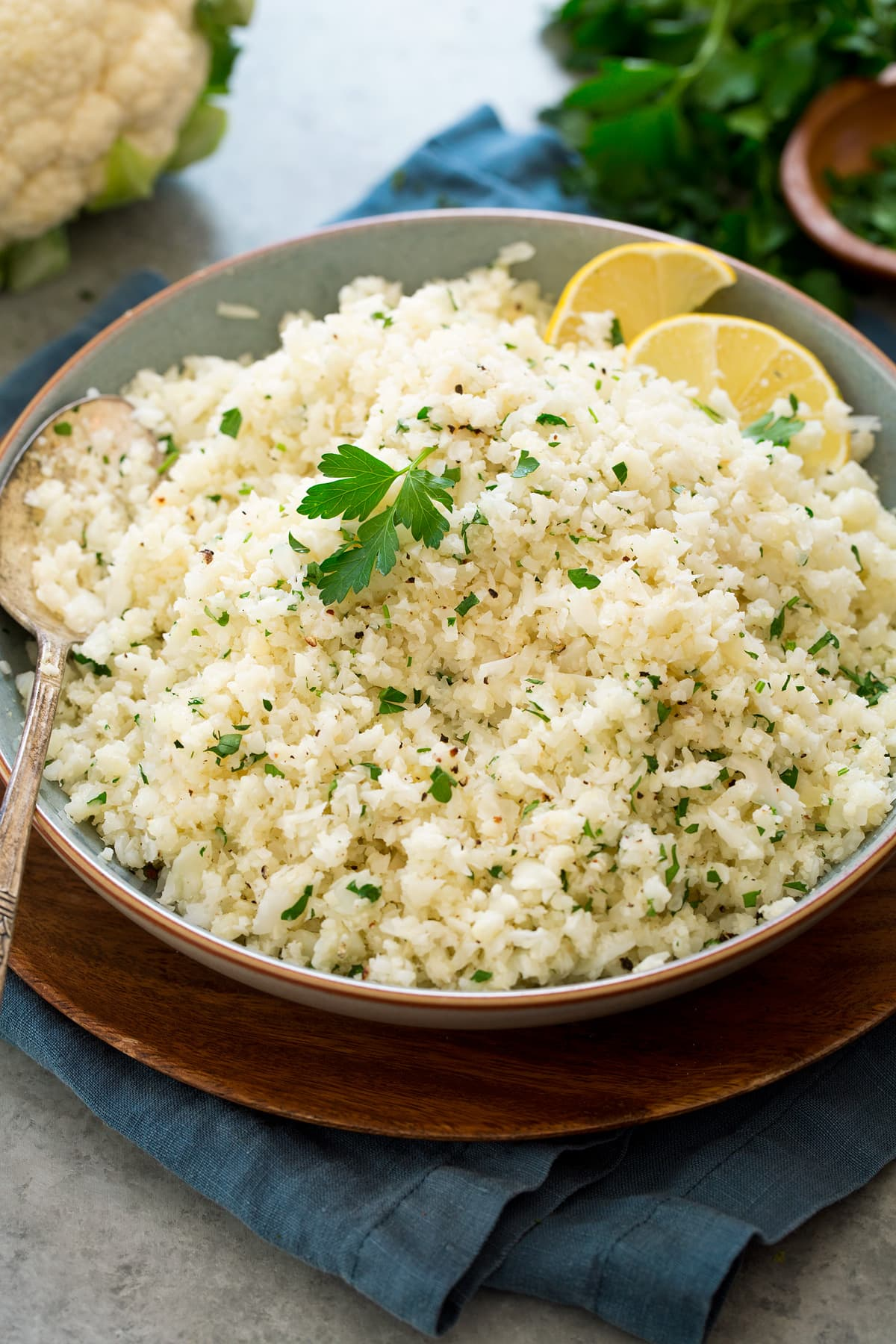 Photo of cauliflower rice shown from the side in a serving bowl.