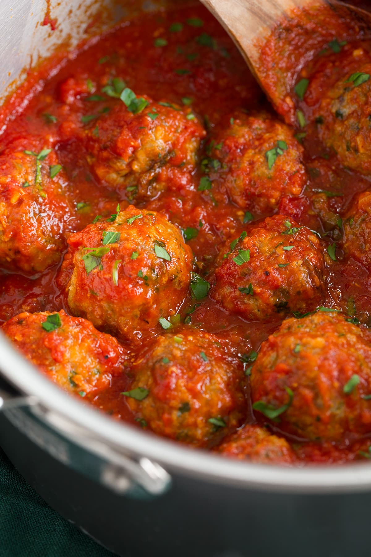 Turkey meatballs in marinara sauce in a saucepan.