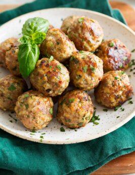 Close up photo of baked turkey meatballs.