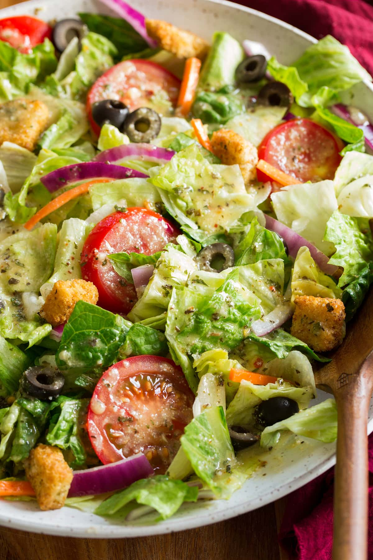 Close up photo of salad tossed with homemade Italian salad dressing.