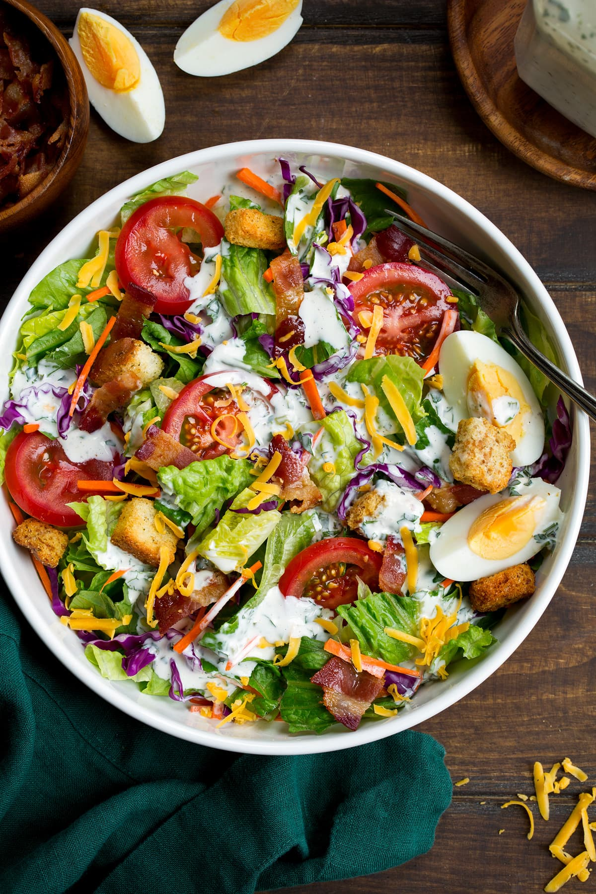 Homemade ranch dressing shown over a green salad.