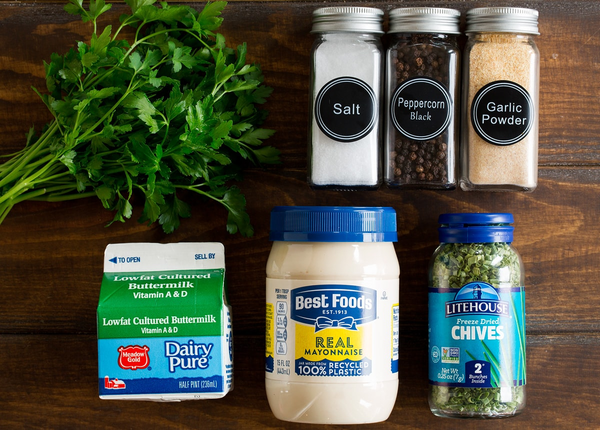 Photo of ingredients used to make ranch dressing. Includes fresh parsley, mayonnaise, buttermilk, dried chives, salt, pepper, and garlic powder.