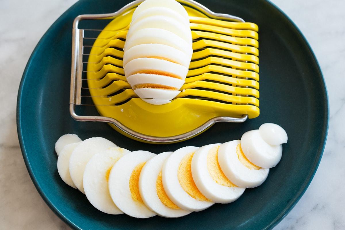 Steamed eggs shown after being sliced in an egg slicer.