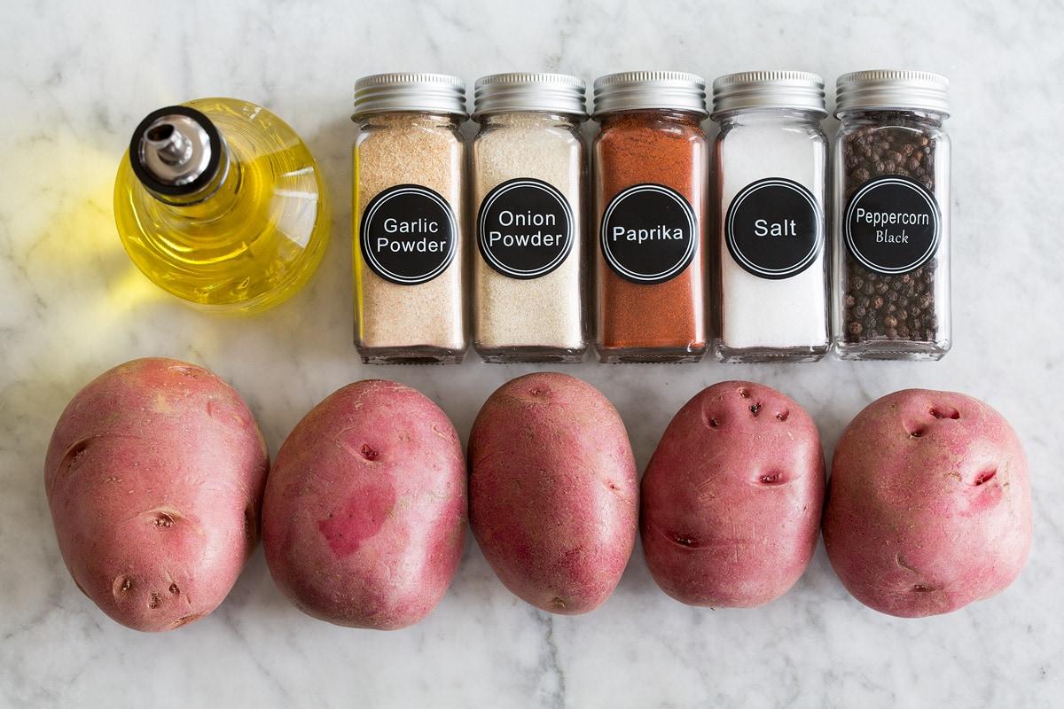 Photo: Red potatoes, olive oil and breakfast potatoes seasonings shown.