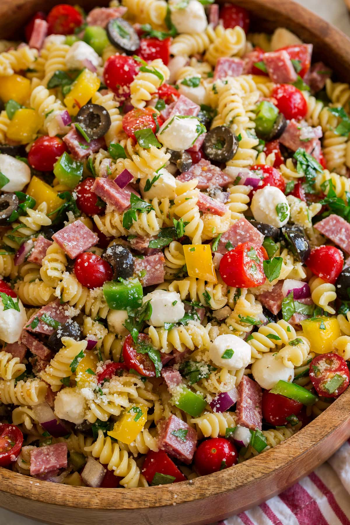 Close up photo of Italian pasta salad showing all the textures and fresh ingredients of the pasta salad.