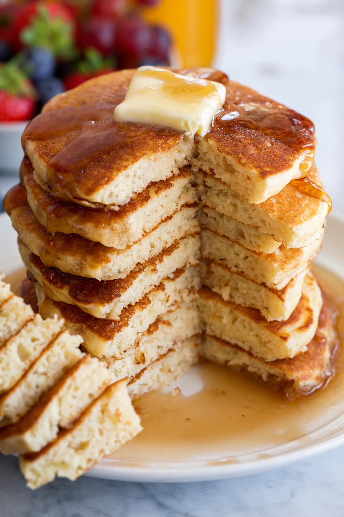 Stack of pancakes with one side cut to show interior.