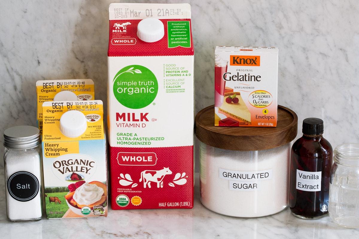 Image of ingredients used to make panna cotta. Includes whole milk, heavy cream, sugar, gelatin, vanilla, salt and water.
