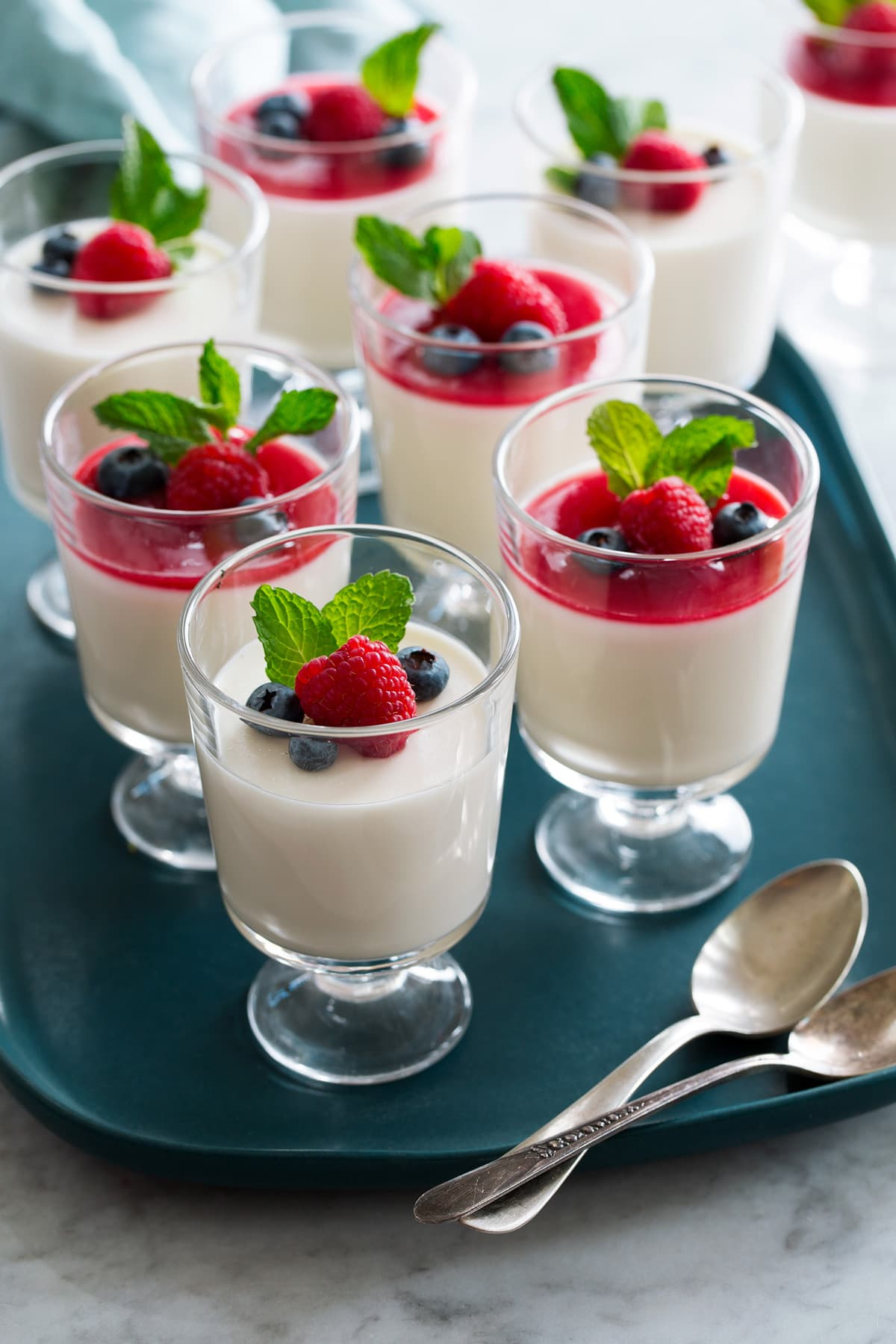 Photo: Eight servings of panna cotta shown in glass dessert cups.