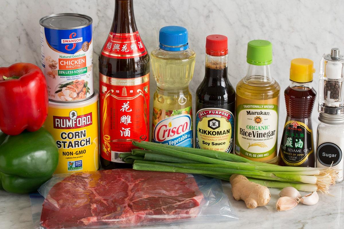 Photo: Ingredients used to make pepper steak shown here. Includes bell peppers, cornstarch, steak, Chinese vinegar, vegetable oil, soy sauce, rice vinegar, sesame oil, green onions, ginger, garlic, salt, pepper and sugar.