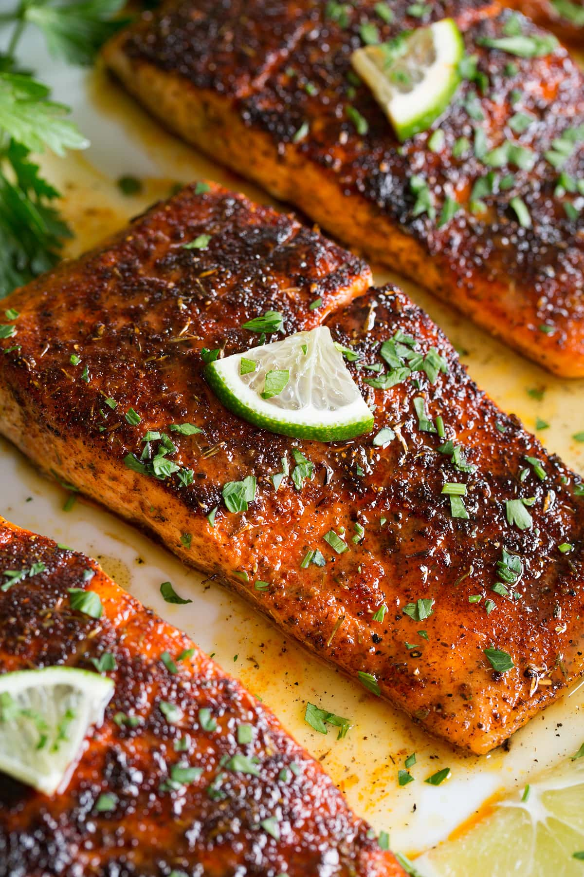 Close up photo of blackened salmon with buttery honey lime sauce.