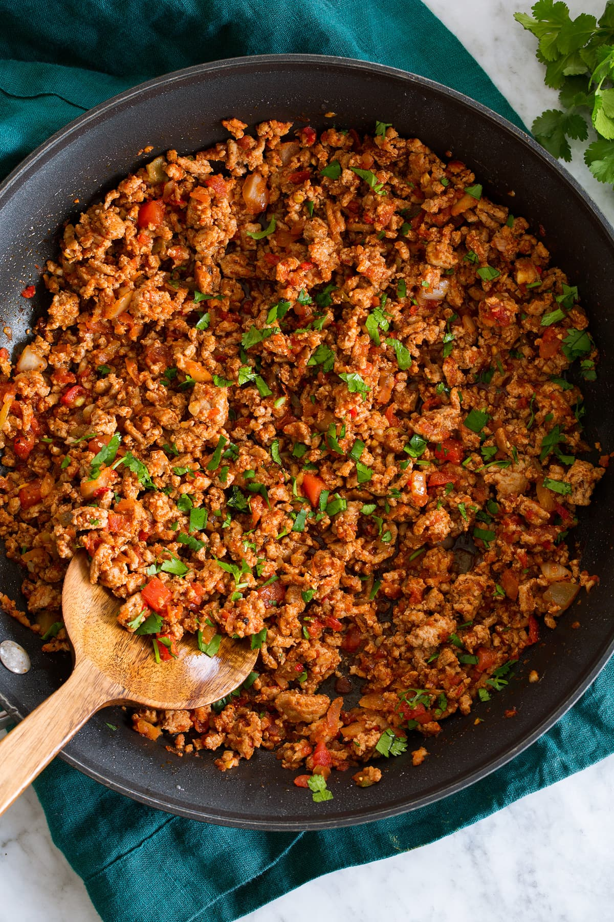 Photo: Ground turkey taco meat in a large black skillet shown from above.