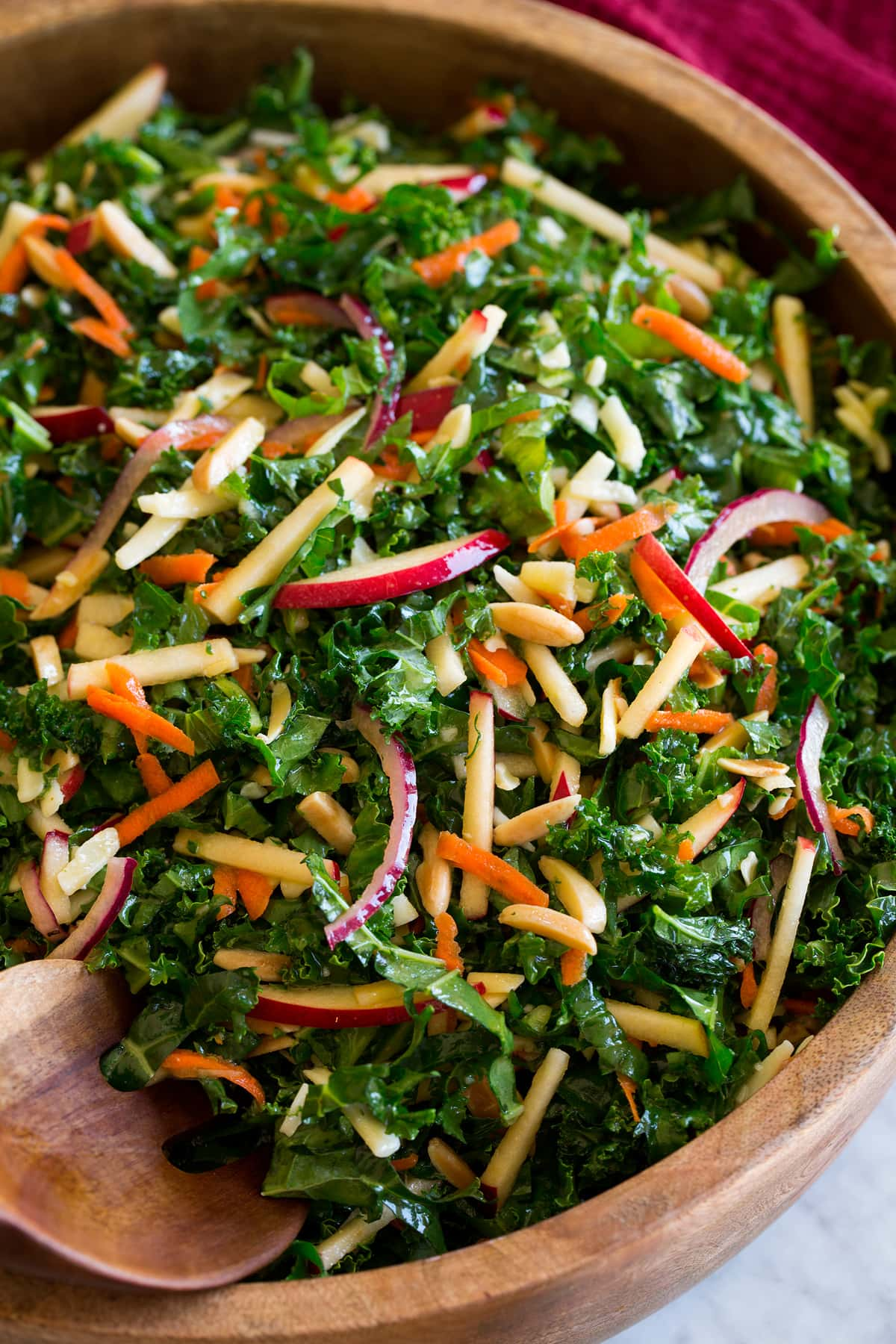 Photo: Shredded kale salad shown close up on a bowl.