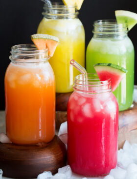 Photo: Four types of aqua fresca including watermelon, cantaloupe, honeydew and pineapple shown in glass mason jars.