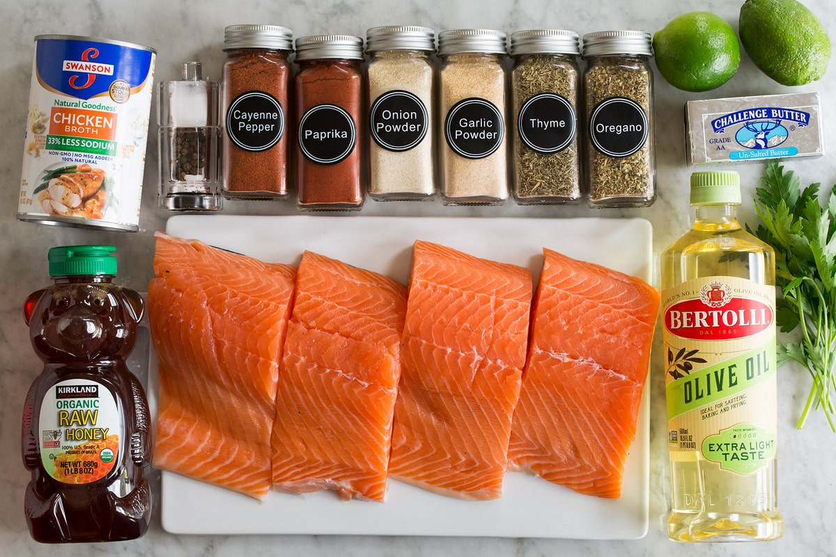Image of ingredients used to make blackened salmon shown overhead on a marble surface.