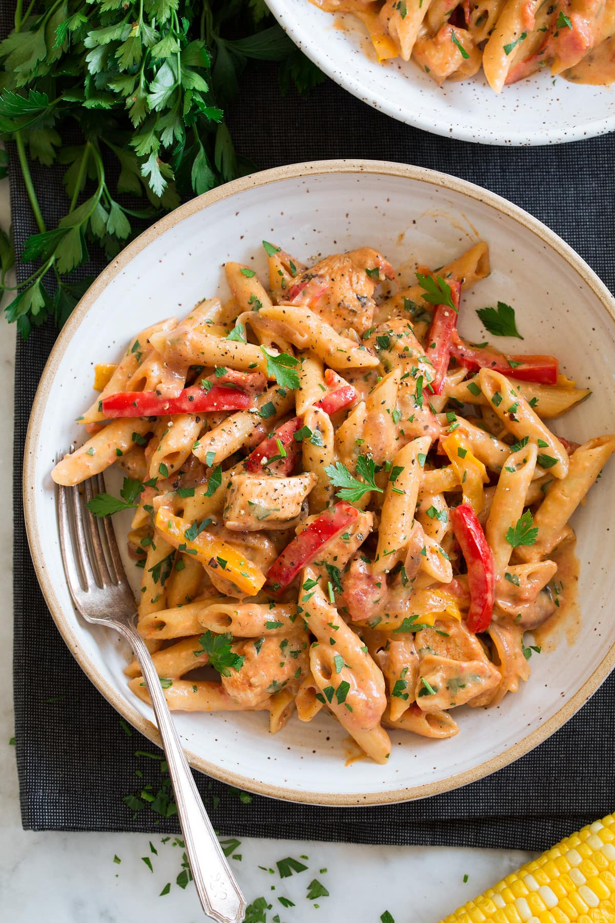 Photo: Serving of cajun chicken pasta in a bowl.