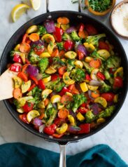 Photo: Sautéed Vegetables shown from above in a black skillet sitting on a marble tabletop.