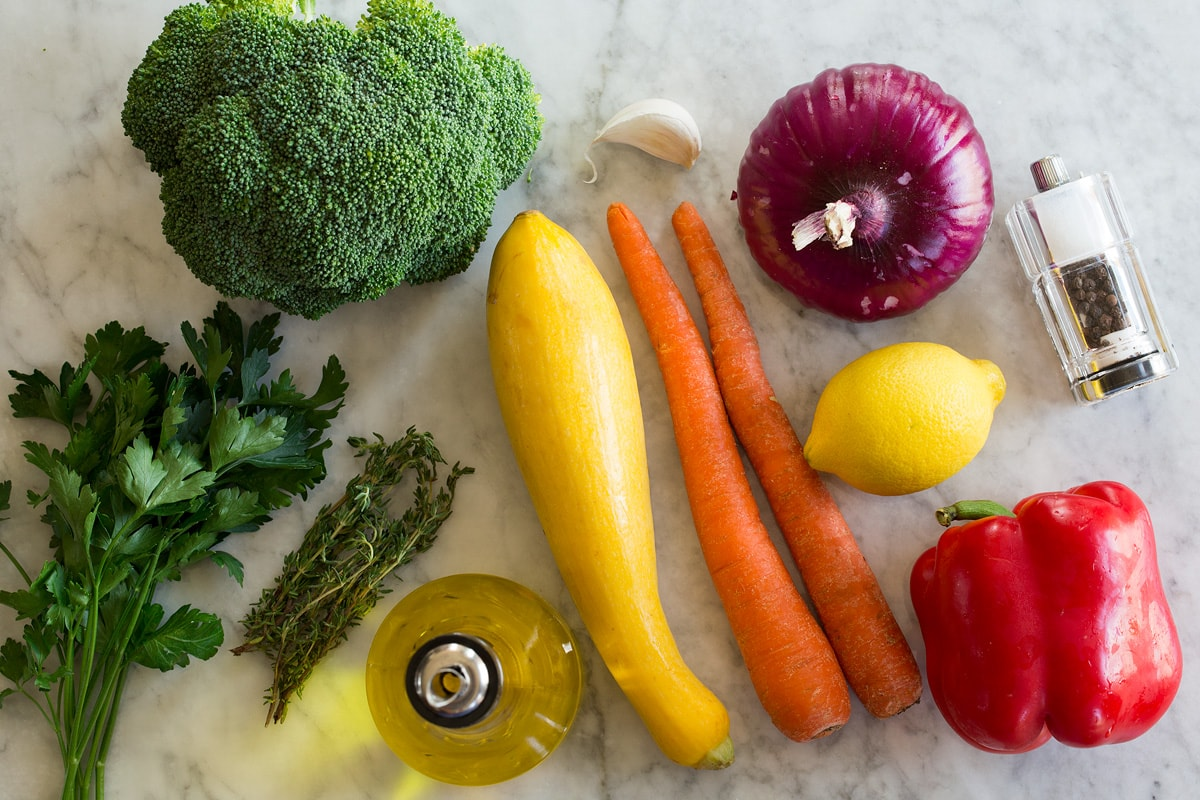 Photo: Ingredients used to make sauteed vegetables shown on a marble countertop.