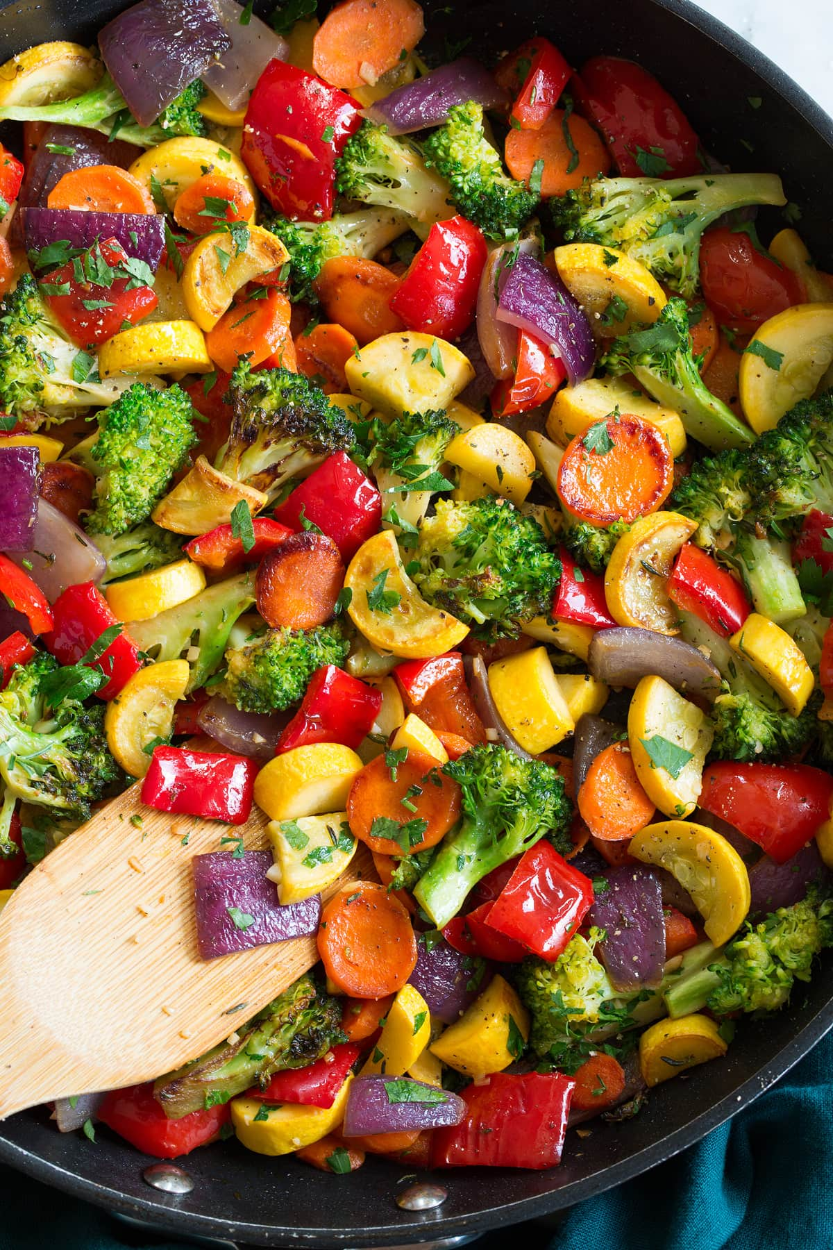 Close up photo of chopped sauteed vegetables in a pan.