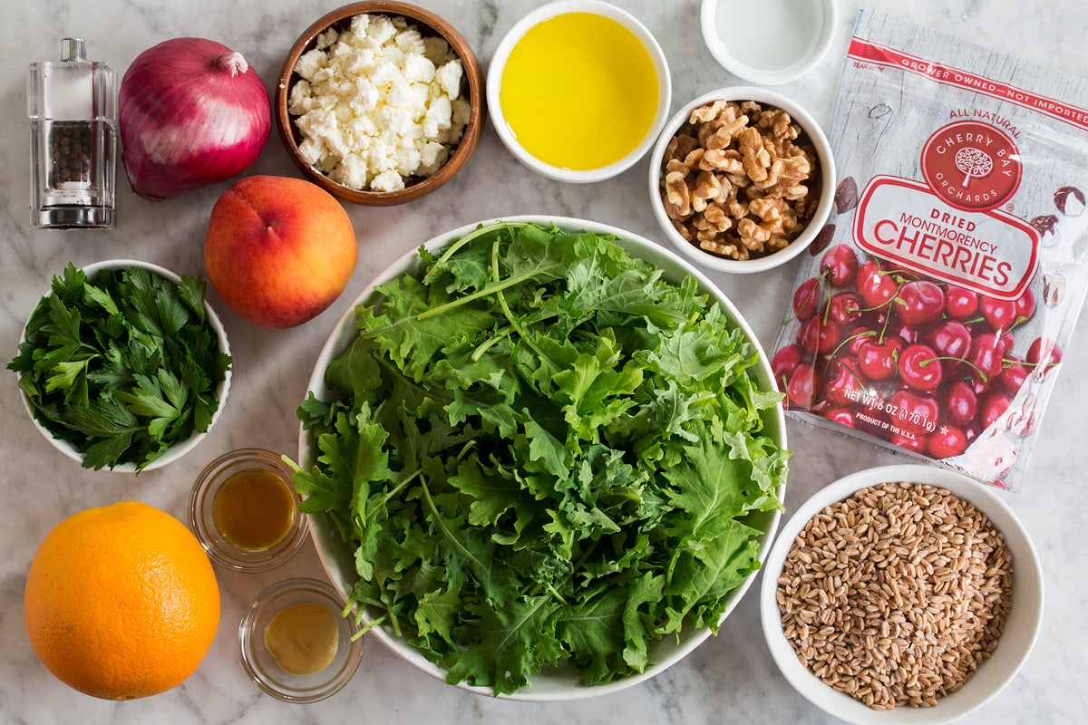 Photo: Ingredients used to make a farro, peach, and kale salad shown.