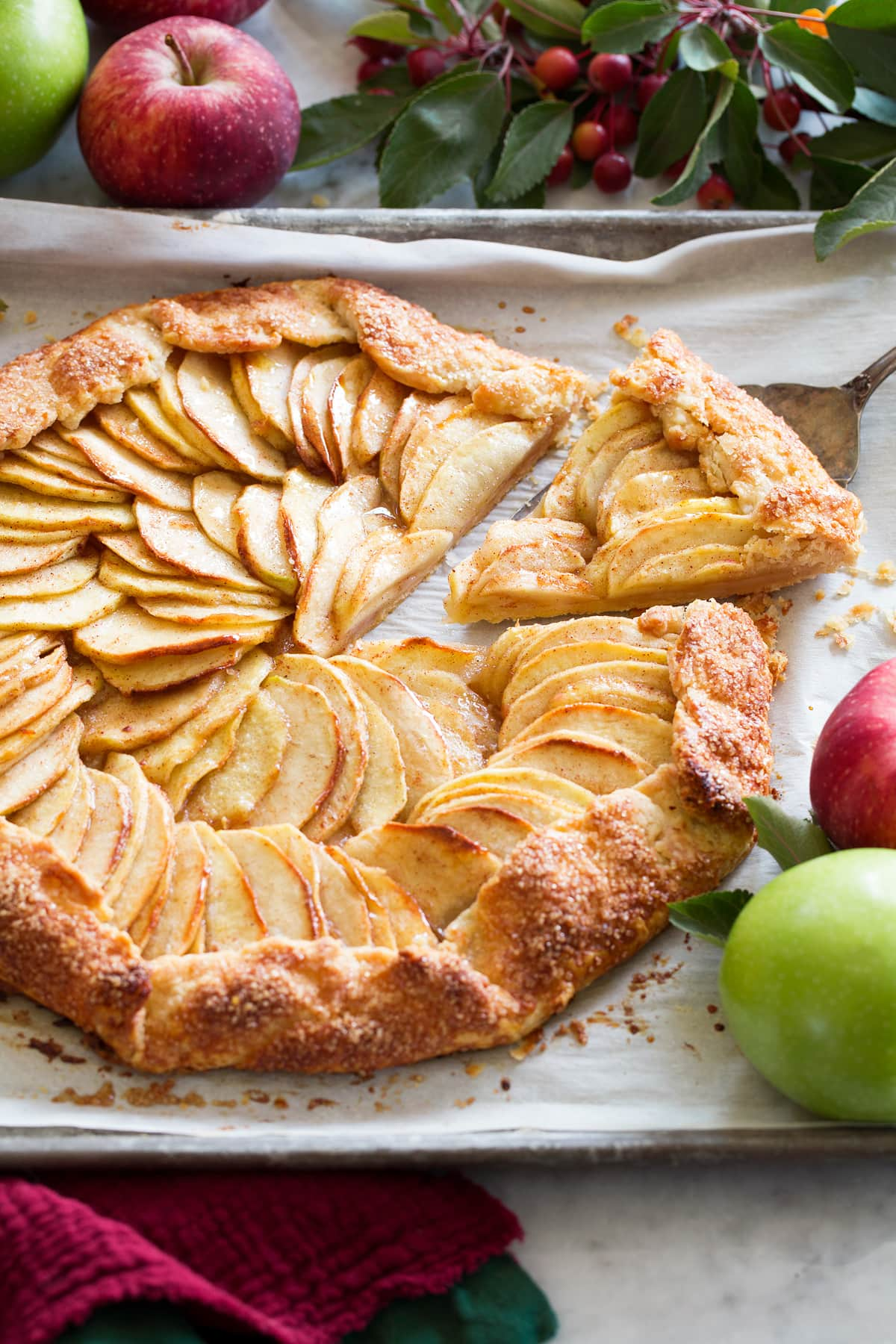 Apple galette with a slice being removed.